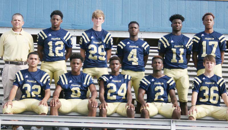 Daily Leader / Marty Albright / Franklin County's receiver corp (from left, kneeling) Jacob Grayson, Tony Wells, Xavier Green, Ladarrius Kettley, Dawson Rockhold; (standing) Coach Anthony Hart, Antonio Hart, Spencer Romero, De'Martre Collins, Isaiah Elam and Jaden Sanxton. The Bulldogs battle Kemper County in the second round of the Class 3A playoffs at East Mississippi Community College. Kick off is at 7 p.m.
