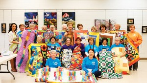 Photo by Kaitlin Mullins The Brookhaven Piecemaker's Quilt Guild presented The Berean Children's Home with 25 handmade quilts on Monday as a donation one year in the making.