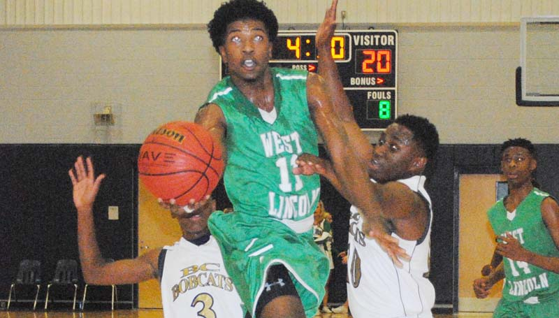 Daily Leader / Marty Albright / West Lincoln's Keshaun London (11) glides through the lane for a layup Thursday night as Bogue Chitto defenders La'Fredrick Dillon (3) and Tyler Brumfield (10) try to deny the play.