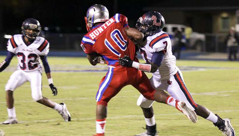 Daily Leader / April Clopton / Brookhaven's defensive back Wesley Calcote (7) works to bring down Pascagoula's running back Reginald Hunter (10) in Friday night Class 5A playoff action.