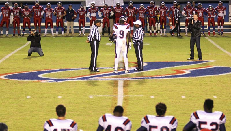 Daily Leader / April Clopton / Prior to the opening kick, Pascagoula held a special ceremony to honor former graduate Keith Joseph Jr. who died in an accident last week. Brookhaven's Darrian Wilson (9) and Pascagoula's Jonathan Boulton (9) met at midfield wearing Joseph's No. 9 Friday night.