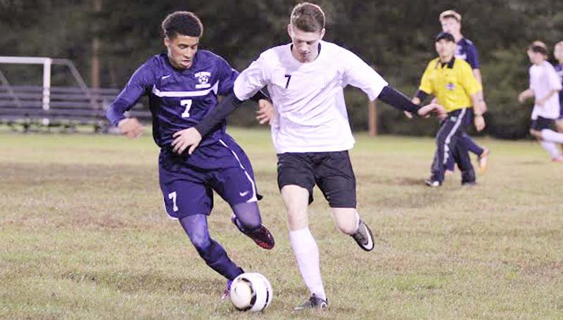 Daily Leader / Amy Rhoads / Loyd Star's Brad Jasper (7) battles against a Brookhaven's Darius Calvin for possession of the ball Thursday night in soccer action.