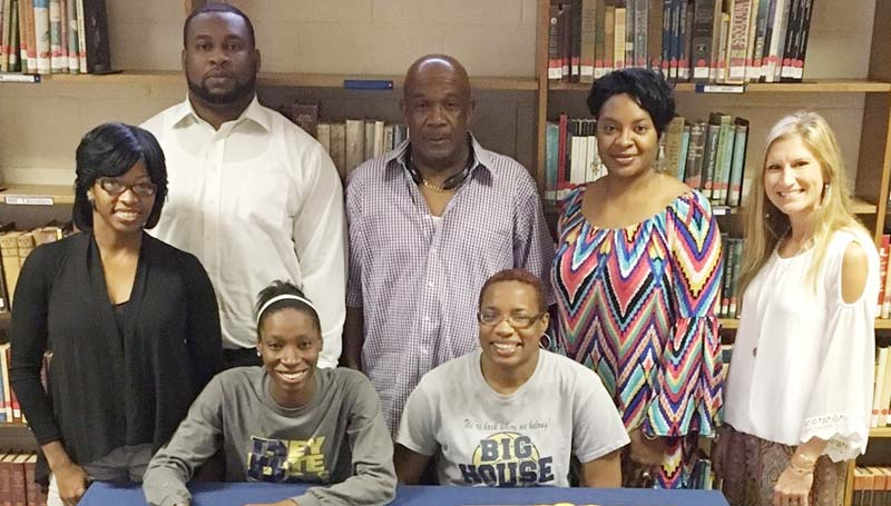 Daily Leader / Photo Submitted / Bogue Chitto Lady Cats senior guard Zariah Matthews has signed a basketball scholarship with the Mississippi College Lady Choctaws. Present for the ceremony was her mom (seated) Fredricka Perkins; (standing, from left) Tarika P. Matthews (aunt), Fred Perkins Jr. (uncle), Mark Nobles, Lorenda Reese (aunt) and Bogue Chitto girls basketball coach Christi Terrell.