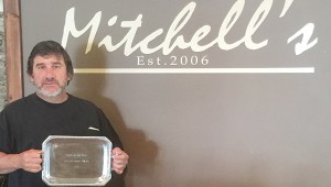 Photo submitted Ken Dixon, chef and general manager of Mitchell's Special Events and Catering, holds the award for winning the 2015 Taste of the Trust People's Choice Award.