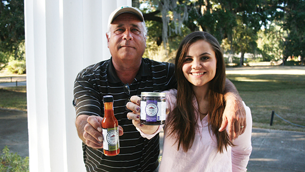 Photos submitted D'Evereux Foods owner Ashleigh Aldridge, pictured here with her dad Courtney Aldridge, has had reason to celebrate as her gourmet pepper jams made in Natchez were named one of Oprah's Favorite Things for the 2015 holiday season. The jams, Huckleberry Jalapeno, Sweet Pepper Jalapeno and Strawberry Jalapeno, can be seen in O, The Oprah Magazine and on Amazon.com.