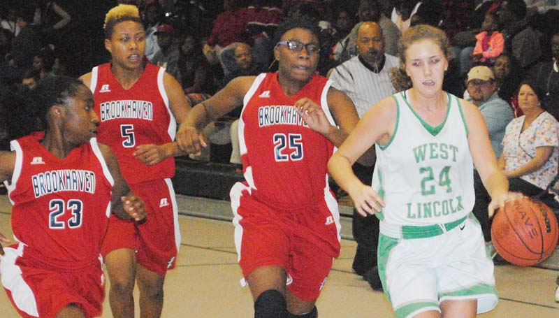 Daily Leader / Marty Albright / West Lincoln's Jana Case (24) dribbles the ball down the court while being pressured by Brookhaven's Johnique James (23), Mya Washington (5) and Tamia Stallings (25) Thursday night.