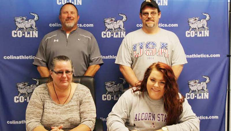 Co-Lin Media / Natalie Davis / Copiah-Lincoln Community College (Miss.) catcher Jessica Crum of Dutchtown, Louisiana (seated right) has signed a letter of intent to play at Alcorn State University (Miss.). Crum led the Lady Wolves in batting average (.480), hits (49), RBIs (59), walks (58) and tied for the team lead in doubles (8). She broke the single season home run record hitting 16 in 2015. The previous record was 10 home runs in a season. Crum was named National Junior College Athletic Association (NJCAA) All-Region 23 and Mississippi Association of Community and Junior College (MACJC) First Team All-State as a freshman. She was named the NJCAA's National Player of the Week following the opening week of the 2015 season when she hit two home runs and had 14 RBIs. Pictured with Crum are her parents, Diane and Tim Crum (standing right) and Lady Wolves head coach Allen Kent.
