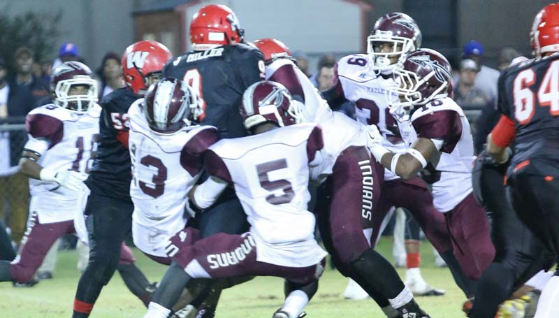 Daily Leader / Jimmy Crockett / Hazlehurst defensive players - Billy Johnson (5), Quetarious West (13), Timmy Staward (10), Dewey Shannon (18), DaQuan Tillman (39), and LeChris Hood (55) - stopped West Marion's top rusher in Friday night at Foxworth.