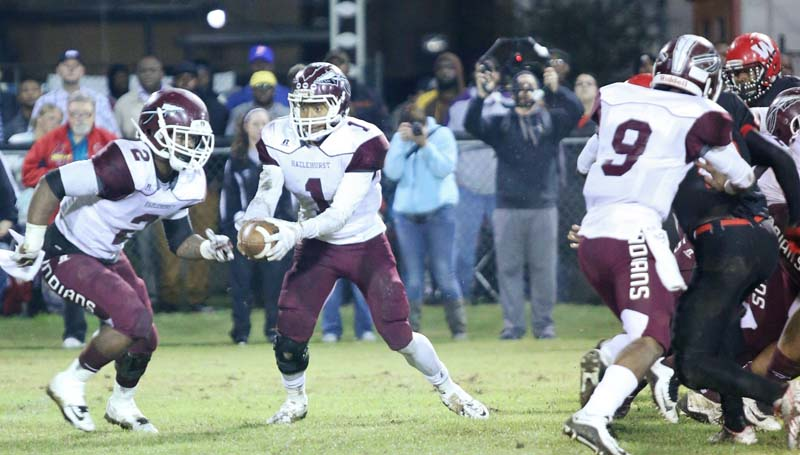 Daily Leader / Jimmy Crockett / Hazlehurst's Laddarious Williams (1) fakes an handoff to Mike Miller (2) while offensive lineman Wykeem Craft (9) provides a block in Friday night action against West Marion.
