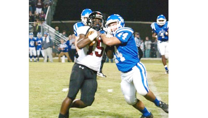 Daily Leader / Jana Harp / Lawrence County Marcus Atterberry fights off an Vancleave defender for more yards Friday night.