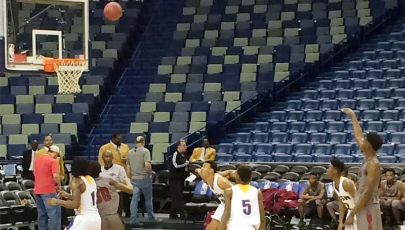 Daily Leader / photo by Tammy Carraway / Lawrence County Keyshawn Feazell (right) releases a free throw shot in Friday afternoon basketball action against Crystal Spring at Smoothie King Center in New Orleans.