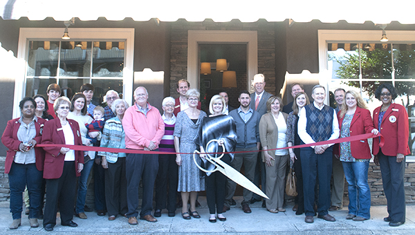 Photo by Julia Miller / Kensy Hoff, center, gathers with family, friends and Chamber of Commerce representatives to celebrate her grand opening Friday afternoon.