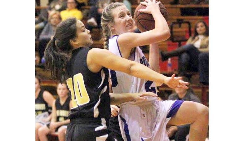 Daily Leader / Sherylyn Evans / Brookhaven Academy's Anna Michael Smith drives to the basket strong against Oak Forest Academy Monday in Parklane's tournament.