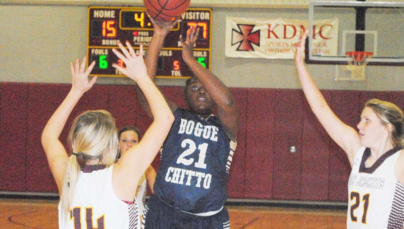 Daily Leader / Marty Albright / Bogue Chitto's Christian Black (21) shoots a jump shot over Enterprise's Karlee Burgess (14) Monday night.