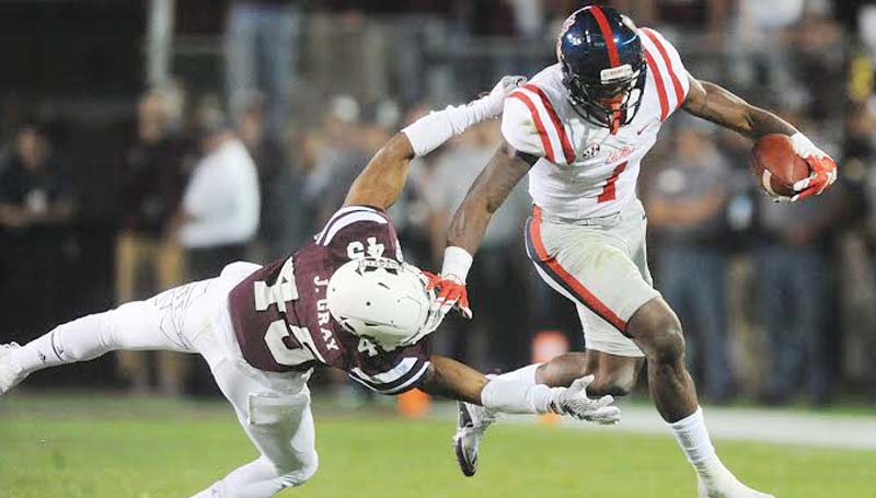 Bruce Newman / Oxford Eagle / Ole Miss Laquon Treadwell (1) eludes an Mississippi State tackler in Saturday's Egg Bowl. The Rebel beat the Bulldogs 38-27.