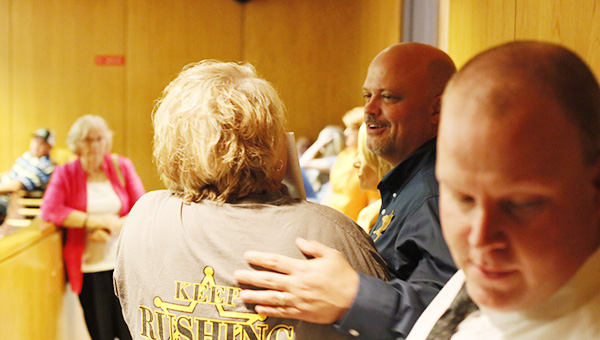Sheriff Steve Rushing talks with a supporter Tuesday night after being elected to another term.