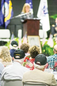 Local veterans look on as Sen. Sally Doty leads the Veterans Day Celebration at the Lincoln Civic Center Tuesday night.