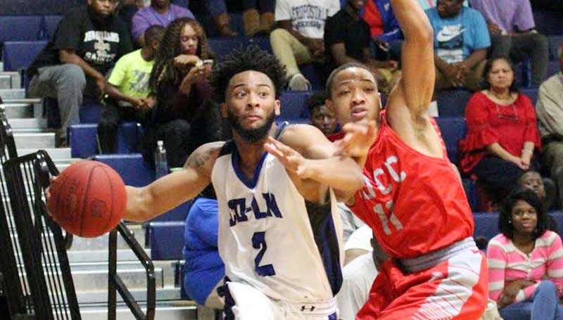 Co-Lin Media / Natalie Davis / Co-Lin's Shemar Williams drives past Mississippi Delta's Roderick Birt.