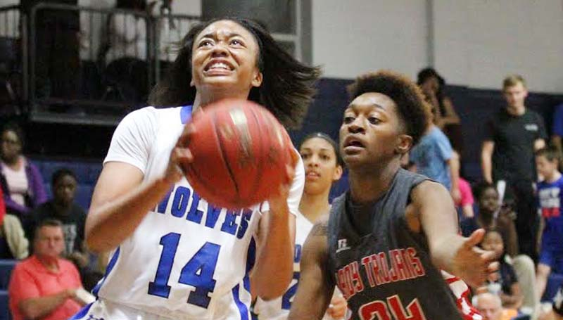 Co-Lin Media / Natalie Davis / Co-Lin's Tytiana Hall drives by Mississippi Delta's TaKayla Dukes in Monday night action at Mullins Gymnasium.