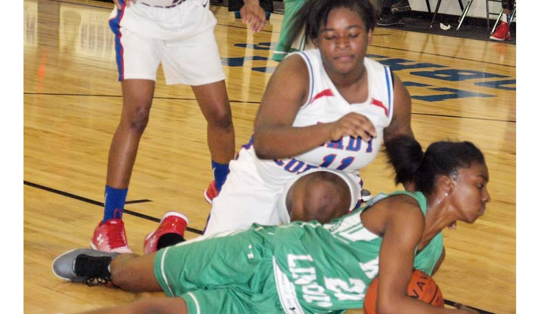 Daily Leader / Tracy Fischer / West Lincoln Demesha Deer (21) looks to call a timeout on the floor before Wesson's Carnesha Green (11) could reach over to get a jump ball call Friday night.