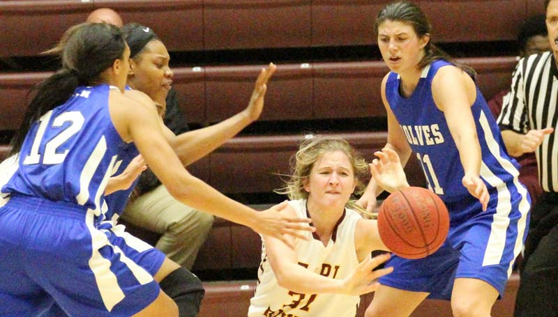Co-Lin Media / Natalie Davis / Pearl River's Alex Cumbest (31) tries to pass through the pressure of Co-Lin's Kelley Allen (11), Jamilah Sanders (12) and Tytiana Hall.