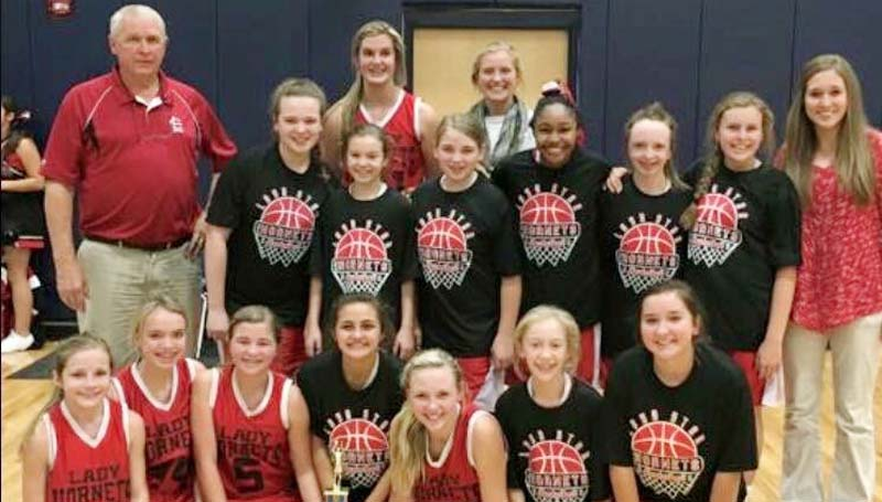 Daily Leader / Photo sumitted / Loyd Star coach Gene Britt and his Lady Hornets won the Lincoln County girls junior high tournament trophy after defeating the Bogue Chitto Lady Bobcats 21-18 Monday night.