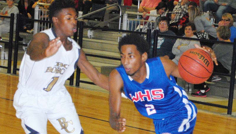 Daily Leader / Marty Albright / Wesson's Eric Rhymes (2) drives the baseline as Bogue Chitto's D.J. Nunnery (1) applies pressure Tuesday night.