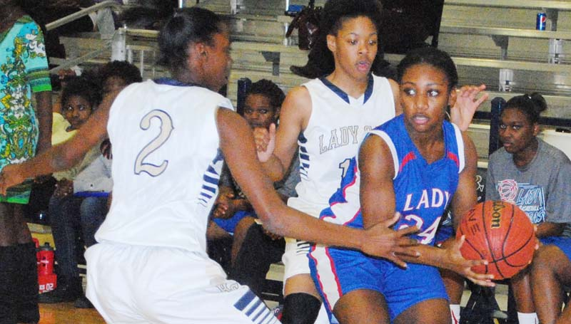 Daily Leader / Marty Albright / Bogue Chitto's Zariah Matthews (2) and Shakirianna Jefferson traps Wesson's guard Alaysha Vaughn (24) in the corner as she looks for some help Tuesday night.
