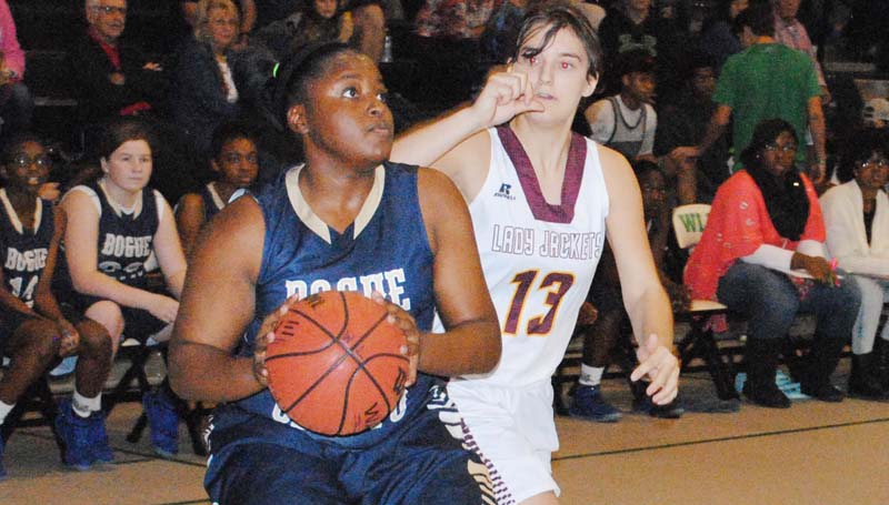 Daily Leader / Marty Albright / Bogue Chitto's Christian Black (21) looks to take a shot Thursday night as Enterprise Michelle Herrington (13) reaches from behind to block the shot.