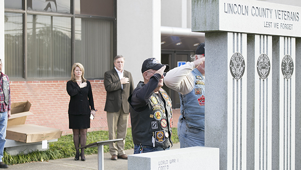 "Photo by Kaitlin Mullins/ Above, members of the Patriot Guard Riders lay a wreath at the  Lincoln County Veteran's Memorial at the Brookhaven-Lincoln County Government Complex Thursday as Sen. Sally Doty and Mayor Joe Cox stand at attention during ""Taps."""