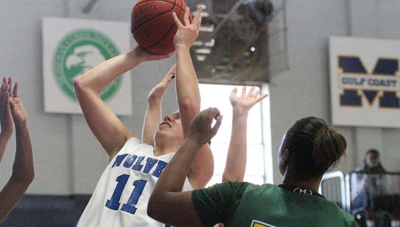 Co-Lin Media / Natalie Davis / Co-Lin's Kelley Allen (11) grabs one of her game-high 12 rebounds against Delgado Saturday afternoon.