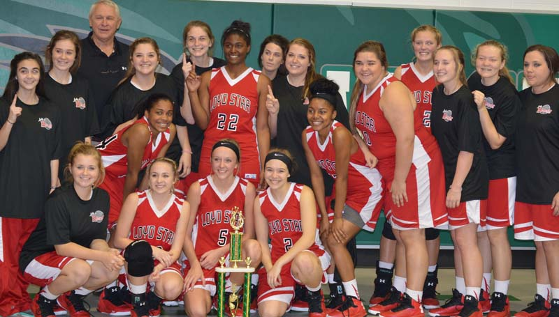 "Daily Leader / Chris King / Loyd Star coach Gene ""Moochie"" Britt and his Lady Hornets gladly pose with Lincoln Country girls trophy after knocking off the Bogue Chitto Lady Cats 57-55 Saturday."