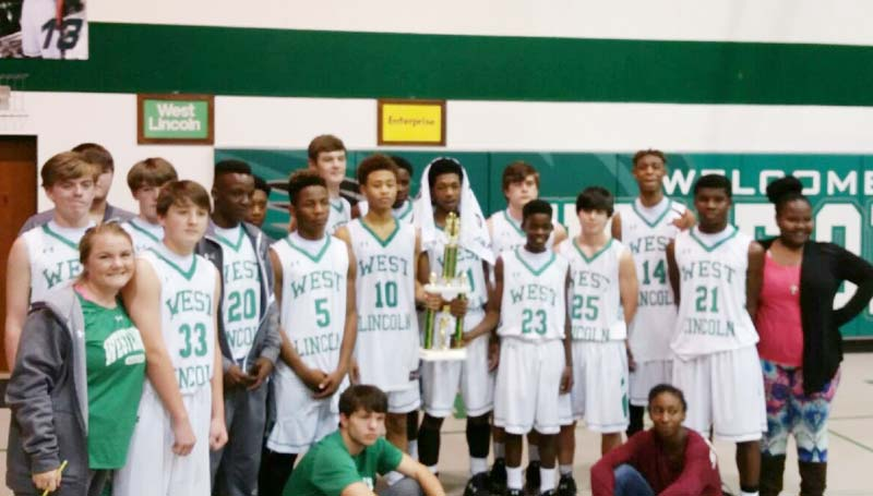 Daily Leader / Photo submitted / West Lincoln coach Lane Young and his Bears won the Lincoln County boys tournament trophy undefeated after defeating the Enterprise Jackets 66-31 Saturday night.