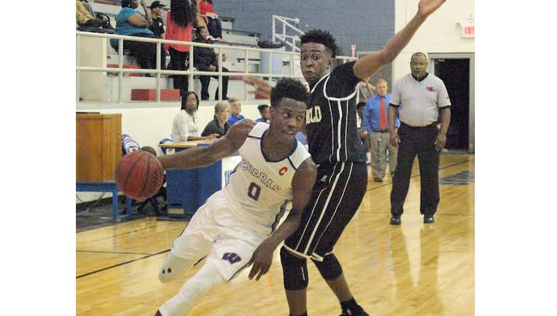 Daily Leader / Tracy Fischer / Wesson's Anthony Jones (0) drives past Bassfield's defender Gerobe Peters (1) in Friday night action at the Snake Pit.