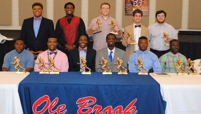 """Daily Leader / Marty Albright / Brookhaven Panthers receiving special awards at Monday night's Ole Brook Football Banquet were (from left, seated) Greg Watts, Therrell-Tanner Award, All-Region 3-5A; Dedric Smith, Most Outstanding Defensive Player, Stan Patrick """"Boom"""" Award, All-Region 3-5A; Willie Bates, Team Captain, All-Region 3-5A; Darrian Wilson, Scholastic Award, Team Captain, All-Region 3-5A; Jordan Blackwell, Most Outstanding Defensive Back; Thomas Poole, Most Outstanding Offensive Back, Most Outstanding Offensive Player, All-Region 3-5A;  (standing) Wanya Morris, Panthers, All-Region 3-5A, MAC All-State; Brandon Rice, All-Region 3-5A, Most Outstanding Offensive Lineman; Stephen Springfield, Most Outstanding Defensive Lineman, All-Region 3-5A; Garrett Smith, Panther and Jordan Nations, Therrell-Tanner Award."""