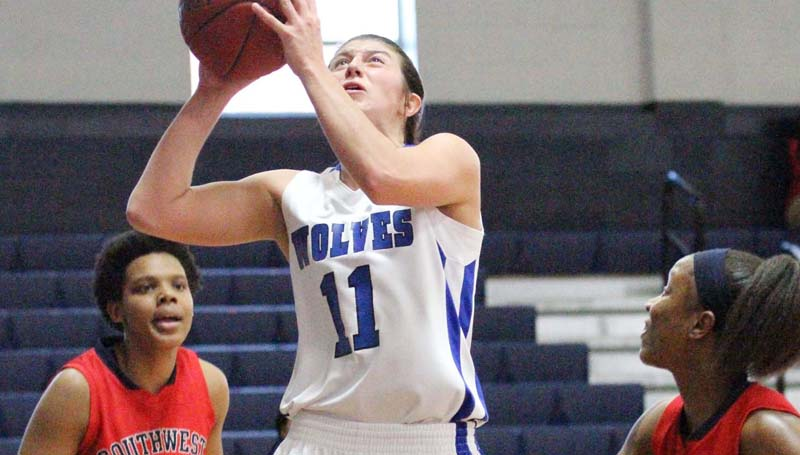 Co-Lin Media / Natalie Davis / Co-Lin's Kelley Allen (11) scores two of her team-high 23 points Monday at Mullen Gymnasium.