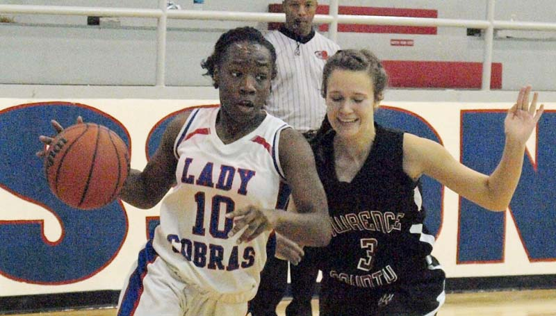 Daily Leader / Tracy Fischer / Wesson's Tashay Glasper (10) drives to the basket while being pressured by an Lawrence County defender Monday night.