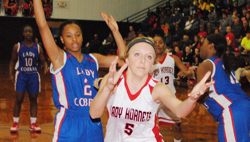 Daily Leader / Marty Albright / Loyd Star's Makenzie Smith (5) reaches to save the ball from going out of bounds, while Wesson's Aurianna Vaughn defends in girls action Tuesday night.