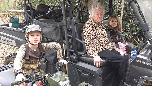 Photo submitted/ Evelyn Davis, center, will celebrate her 100th birthday after Christmas. She has lived her whole life in Lincoln County. She is pictured with her great-grandchildren Cam Walker and Carolina Walker.