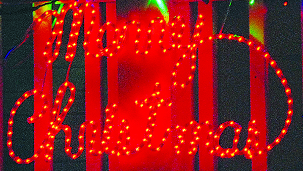 """Photo by Aaron Paden / A house on N. Jackson Street has lights that spell """"Merry Christmas."""""""