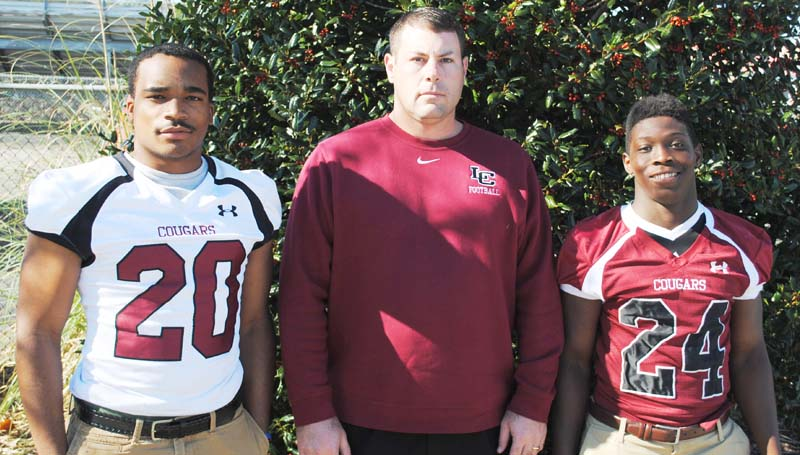 Daily Leader / Marty Albright / Lawrence County's T-Tex Cole, Coach Jaymie Palmer and Quitten Brown received big honors in the All-Region 6-4A selection. Cole earned the Defensive Player of the Year award. Palmer was named the Coach of the Year and Brown received the Player of the Year honors.