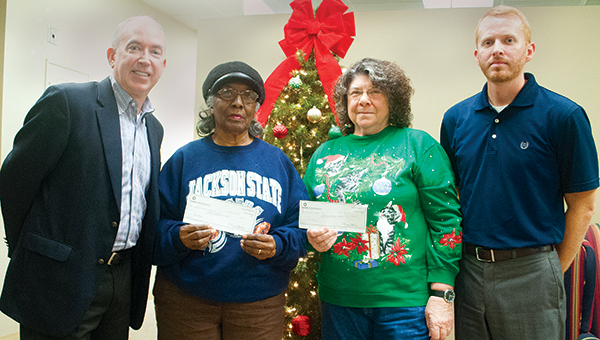 Photo by Julia Miller / The Daily Leader and Bank of Brookhaven distributed checks to local food pantries as part of the annual Holiday Food Pantry Drive. Pictured are (from left) Shannon Aker, Bank of Brookhaven president; Flora Kelly, of the Greater Hope Foundation; Alice Methvien, St. Francis Catholic Church and St. Vincent de Paul Food Pantry; and Luke Horton, Daily Leader publisher.