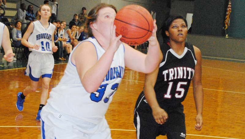 Daily Leader / Marty Albright / Brookhaven Academy's Cameron Watson (33) scores two of her team-high six points Monday night against Trinity at John R. Gray Gymnasium.
