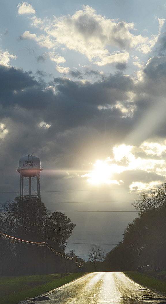 The sun breaks through the clouds on a recent morning in Lincoln County. More rain is expected today and tonight, with an expected high temperature of 58.
