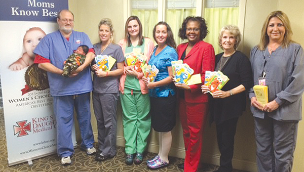Photos submitted From left: Dr. Mitch Holland; Kim Leveque ; Nadine Teasley; Ladonna Fuller; Rita Robinson, Willing Hearts Literacy Committee chairman;  Katherine  Bumgarner, Willing Hearts Literacy Committee member; and Angie Williamson KDMC LDRP manager.