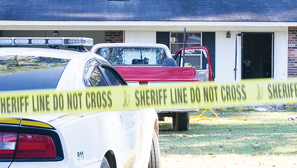 Photo by Kaitlin Mullins/ The scene at 421 River Road Drive after Lincoln County Sheriff's deputies attempted to serve a warrant to Christopher Hamilton, 40. Hamilton shot at deputies, who returned fire.