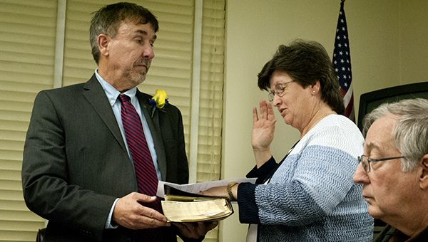Diane Gill (right) makes her oath as she joins the LCSD board of trustees.