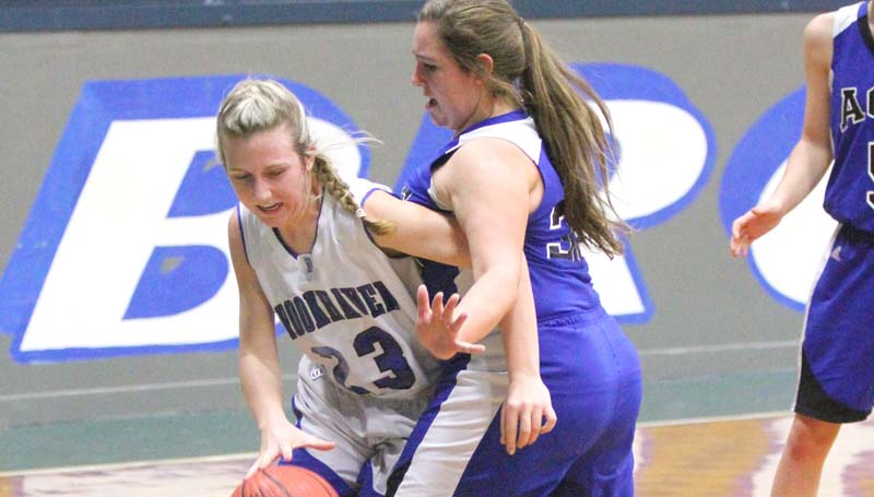 Daily Leader / Sherylyn Evans / Brookhaven Academy's Anna Michael Smith (23) fights to drive the baseline in girls' action Tuesday night against ACCS.