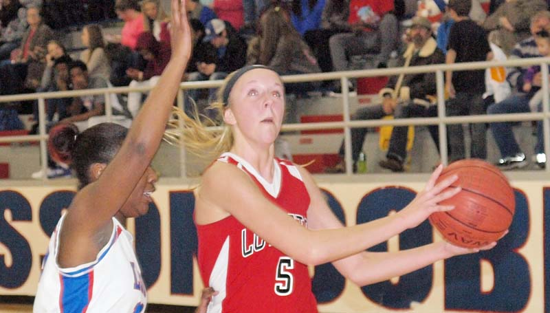 Daily Leader / Tracy Fischer / Loyd Star's MaKenzie Smith (5) drives in for a layup against Wesson's Jamiya Christmas (13) Tuesday night.