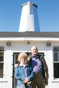 Photo by Kaitlin Mullins / Agnes and Buck Ratliff stand before the Coffee Pot Inn during its historical marker unveiling on Wednesday. Buck Ratliff's father owned Ratliff Sheet Metal Works and is responsible for the famous feature.